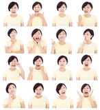 Asian young woman making different facial expressions. Over white background Royalty Free Stock Images