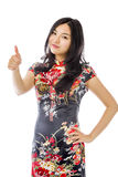 Asian young woman making thumbs up sign standing with hand on hip Stock Images