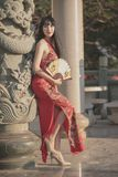 Asian young woman in old traditional Chinese dresses in the Temple. Asian young woman in old traditional Chinese dresses in the Temple at Thailand royalty free stock images