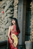 Asian young woman in old traditional Chinese dresses in the Temple. Asian young woman in old traditional Chinese dresses in the Temple at Thailand stock photo