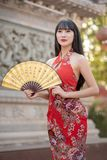 Asian young woman in old traditional Chinese dresses in the Temple. Asian young woman in old traditional Chinese dresses in the Temple at Thailand stock photography