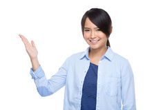 Asian young woman open palm present Royalty Free Stock Images
