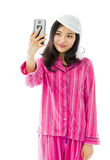 Asian young woman photographing herself with her mobile phone Stock Images