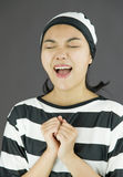 Asian young woman pleading in prisoners uniform Stock Image