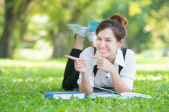Asian young woman pointing in park Stock Photos