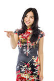 Asian young woman pointing something Royalty Free Stock Photography