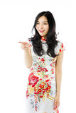 Asian young woman pointing something Royalty Free Stock Images