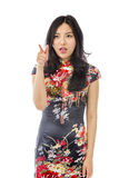 Asian young woman with pointing  on white background Stock Photography