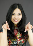 Asian young woman pointing at you from both hands  on colored background Stock Image