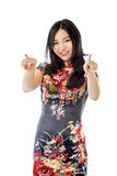 Asian young woman pointing at you from both hands isolated on white background Royalty Free Stock Images