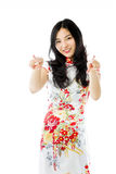 Asian young woman pointing at you from both hands isolated on white background Stock Photography