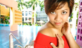 Asian young woman by the pool Stock Photos