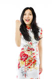 Asian young woman punches fist into the air isolated on white background Stock Photography