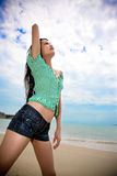 Asian young woman relaxing at the beach Royalty Free Stock Image