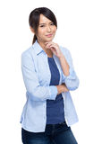 Asian young woman rest chin on hand Royalty Free Stock Images