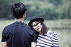 Asian young woman resting on her boyfriend`s shoulder with love Royalty Free Stock Image