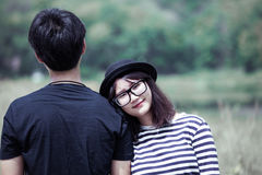 Asian young woman resting on her boyfriend`s shoulder with love Royalty Free Stock Photo