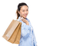 Asian young woman with shopping bag Stock Photography