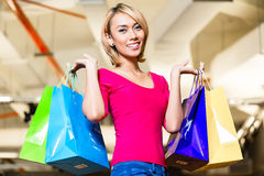 Asian young woman shopping fashion in store Royalty Free Stock Photos