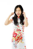 Asian young woman shouting with hands in ear Stock Photos