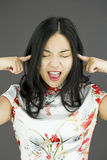Asian young woman shouting with hands in ear Stock Images