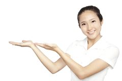 Asian  young woman show your product isolated Stock Photography
