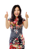 Asian young woman showing thumbs up from both hands isolated on white background stock photography