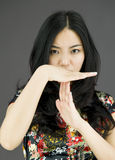 Asian young woman showing timeout signal Royalty Free Stock Photo