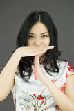 Asian young woman showing timeout signal Stock Photo