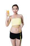 Asian young woman slim fit  is Drink orange juice and measuring Stock Photos