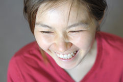 Asian young woman smiling Royalty Free Stock Photography