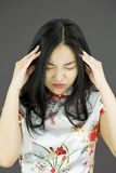 Asian young woman suffering from headache Stock Image