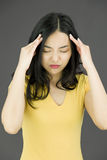 Asian young woman suffering from headache Royalty Free Stock Photos