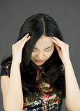 Asian young woman suffering from headache Royalty Free Stock Photo