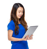 Asian young woman with tablet Royalty Free Stock Photo