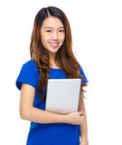 Asian young woman with tablet Stock Image