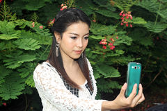 Asian young woman taking picture of herself Stock Images