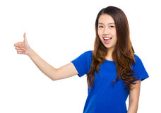 Asian young woman with thumb up Stock Photo