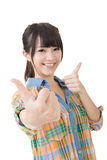 Asian young woman thumbs up Royalty Free Stock Photography