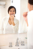 Asian young woman tooth brushing her teeth happily Royalty Free Stock Photos