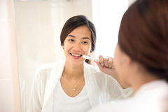 Asian young woman tooth brushing her teeth happily Stock Image