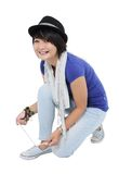 Asian young woman tying shoe Royalty Free Stock Photography