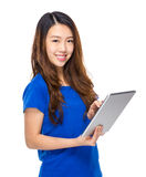 Asian young woman use tablet Stock Photography