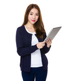 Asian Young Woman use of the tablet pc Stock Image
