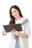 Asian young woman using pad Stock Photography