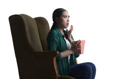 Asian young woman watching a horror movie and eat popcorn with s Royalty Free Stock Photos