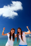 Asian young women enjoy the sun. Stock Photos