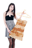Asian young women shopping. Asian young women in the choice of her favorite fashion Stock Photos