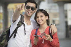 Asian younger backpack man and woman happy traveling destination Royalty Free Stock Photos