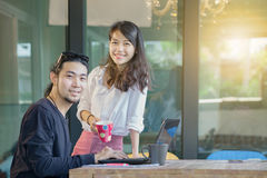 Asian younger freelance man and woman happiness emotion working Stock Images